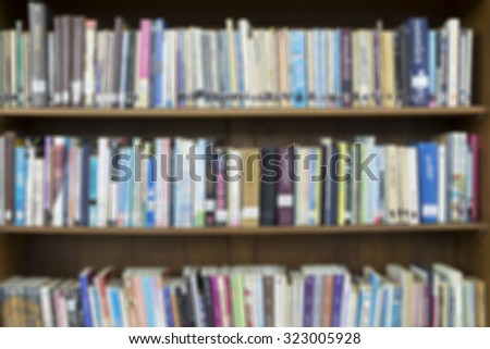 Blured books in library. - stock photo