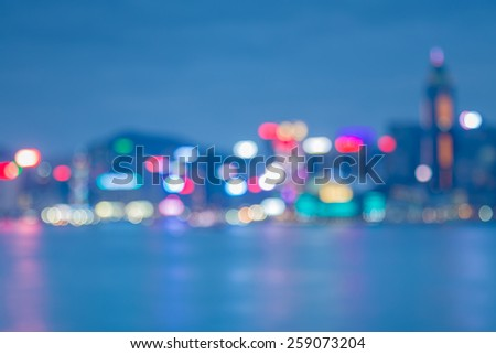 Blured lights of Hong Kong city twilight with water reflexion   - stock photo