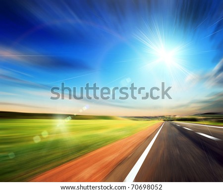 blured road and blured sky with sun - stock photo