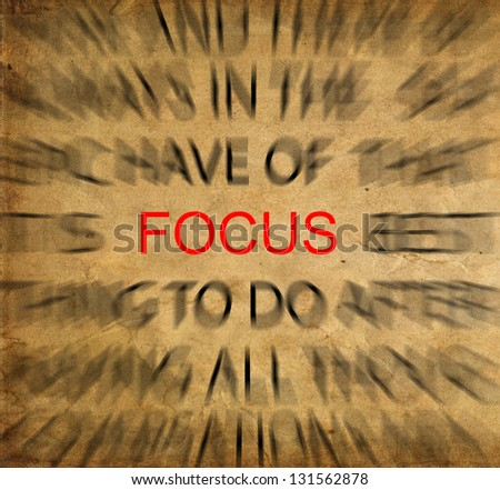 Blured text on vintage paper with focus on FOCUS - stock photo