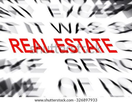 Blured text with focus on REAL ESTATE