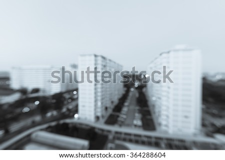Blurred abstract background aerial view of Eunos neighborhood in Singapore at blue hour. Colorful defocused bokeh lights from new buildings and tennis, basketball couts. Urban cityscape background - stock photo