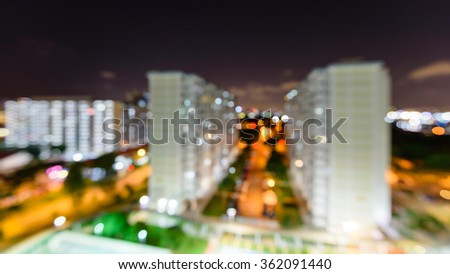 Blurred abstract background aerial view of Eunos neighborhood in Singapore at night. Colorful defocused bokeh lights from new buildings and tennis, basketball couts. Urban cityscape background - stock photo