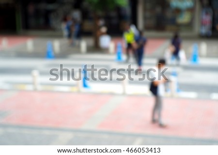 Blurred abstract background and can be illustration to article of people walking