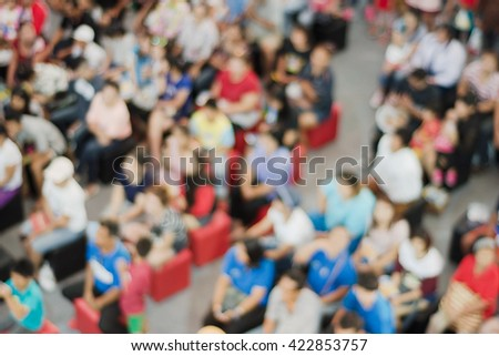 Blurred abstract background Crowd people sitting in hall