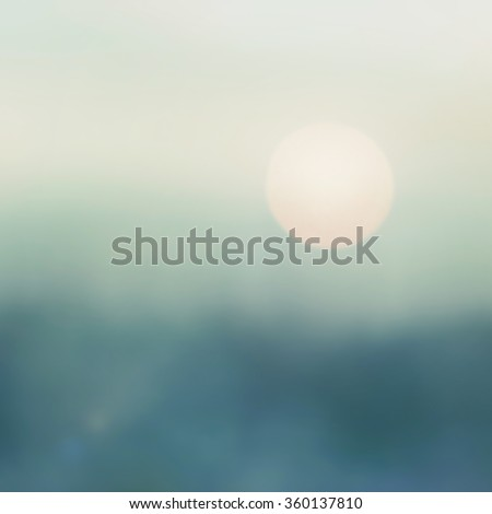 Blurred abstract background last light evening w/ sunset rush dark hour over dreamy mountain landscape utopia of holiday vacation night life bokeh cool vintage blue green pastel hazy winter color tone - stock photo
