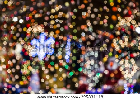 Blurred abstract background lights, beautiful Christmas lights. Colorful defocused Christmas lights in the background.