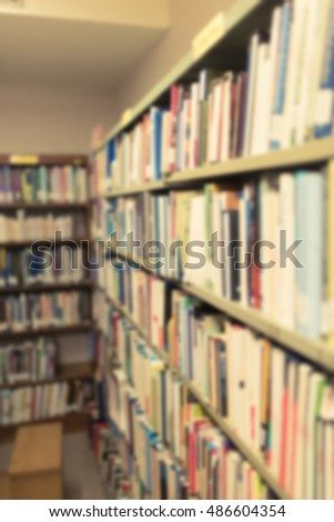 Blurred abstract background of book shelves row and interior of publiclibrary with textbooks, literature, menuscript, thesis and magazines. - Vintage Tone