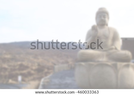 Blurred abstract background of Buddha located in the hills.
