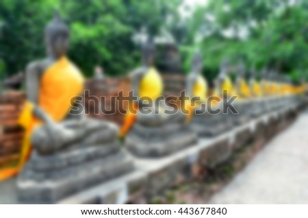 Blurred abstract background of Buddha statue - stock photo