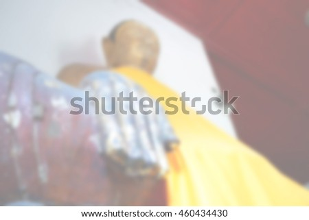 Blurred abstract background of Buddha statue