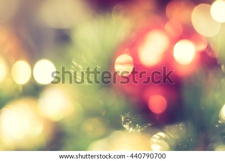 Blurred abstract background of christmas party celebration xmas tree night light bokeh in warm green red yellow orange white sweet tone: Blurry happy holiday enjoy urban downtown nightlife cafe view - stock photo