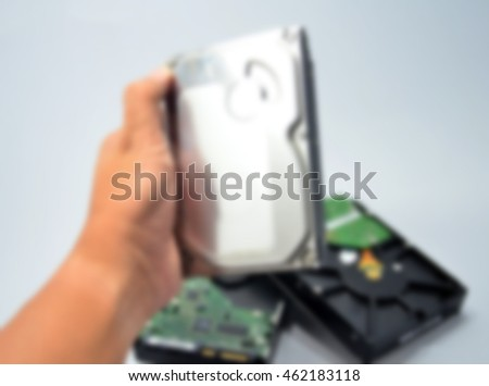 Blurred abstract background of hand hold hard disk