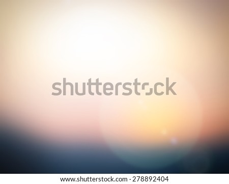 Blurred abstract background of morning light on the sky with bokeh and sun flare - stock photo