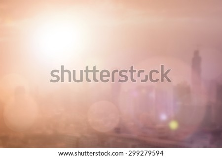 Blurred abstract background of morning sunrise gold light view business downtown Bangkok cityscape with bright sun flare and bokeh in retro style: Blur holiday travel backgrounds of smokey sun shine - stock photo
