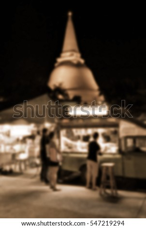 Blurred abstract background of Night Market Wat Phra Pathom Chedi, Thailand.
