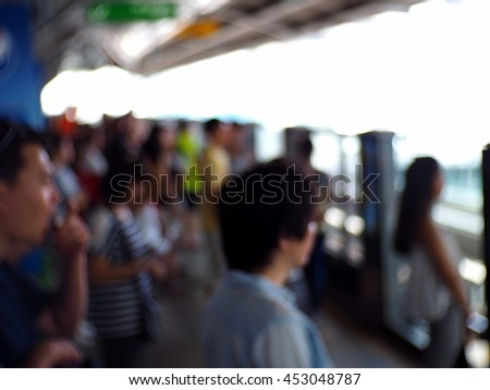 Blurred abstract background of people at train station