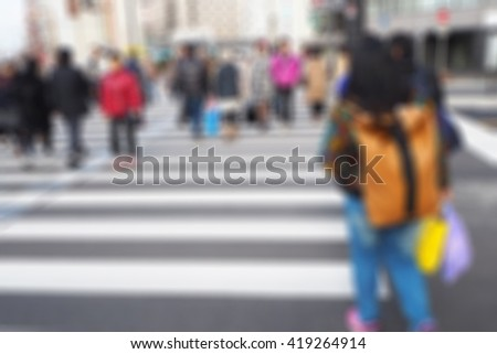 Blurred abstract background of People crossing the street