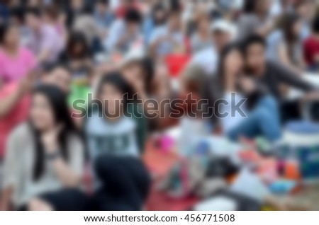 Blurred abstract background of people in festivel