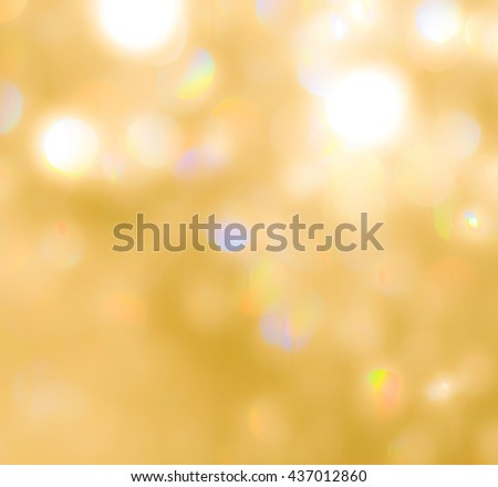 Blurred abstract background of reflective yellow gold magical shiny bokeh crystal chandelier lamp bright golden color lighting vintage colour tone: Sparkling festival holiday lights glass reflection - stock photo