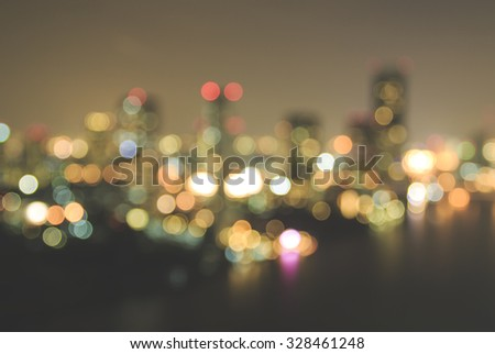 Blurred abstract background of rooftop view of city night light bokeh. World City Day, Africa Industrialisation, Merry Christmas, Happy New Year, Card, Business, Office, Hour, Working, Missing concept - stock photo