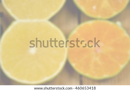 Blurred abstract background of Slice of fresh orange
