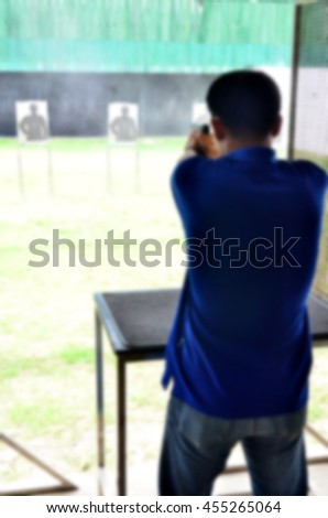 Blurred abstract background of The Gun Shooting - stock photo