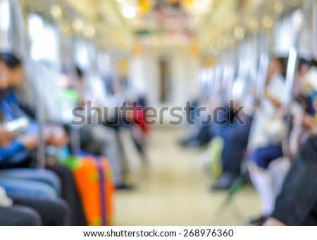 Blurred abstract background of Tokyo metropolitan electric train with commuters - stock photo