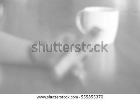 Blurred abstract background of use phone in coffee shop