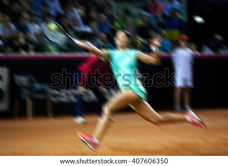 Blurred abstract background of woman playing tennis in court - stock photo