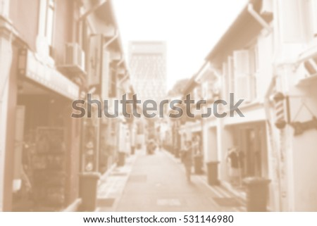 Blurred abstract background of Woman walking in neighborhood stores.