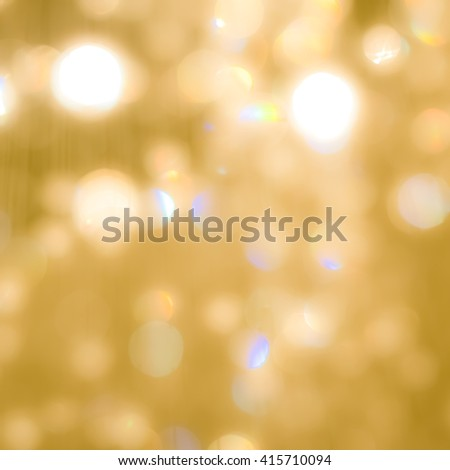 Blurred abstract background reflective colorful rainbow bokeh crystal mobile chandelier lamp shiny yellow gold color lighting vintage tone Festive holiday sparkling light crystal glass reflection - stock photo