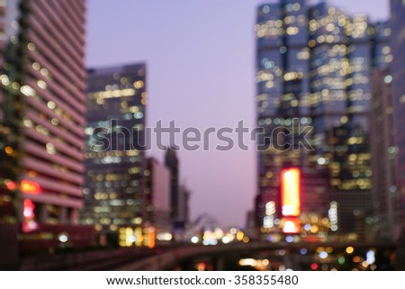 Blurred abstract background with colorful bokeh night lights of downtown city lights. High rise building of Bangkok. - stock photo