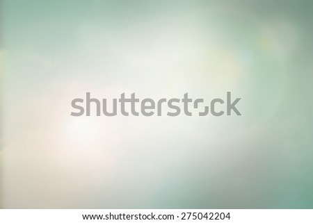 Blurred abstract background with double exposure of clouds on sky , sun flare and bokeh in vintage style  - stock photo