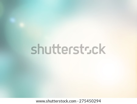 Blurred abstract background with glowing light flare and bokeh in cyan and warm yellow color tone  - stock photo