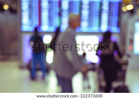 blurred airport terminal - flight timetable passengers - stock photo