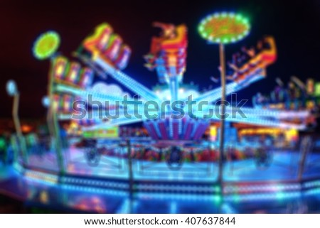 Blurred Amusement park ride at night. conceptual image of entertainment & fun - stock photo