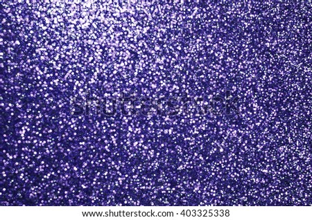 Blurred and defocused glittering lights background with highlighted spot / Abstract background / For festive and holiday background - stock photo