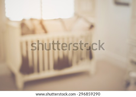 Blurred Baby Crib with Retro Instagram Style Filter - stock photo