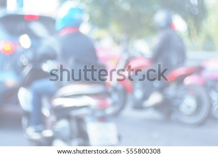 Blurred  background abstract and can be illustration to article of Man seat on the motorcycle