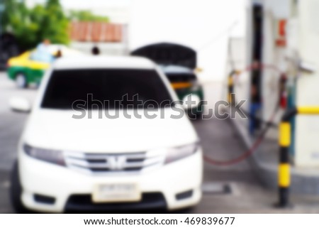 Blurred  background abstract and can be illustration to article of Petrol pump filling