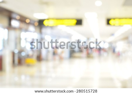 Blurred background : airport terminal blur background with bokeh light - stock photo