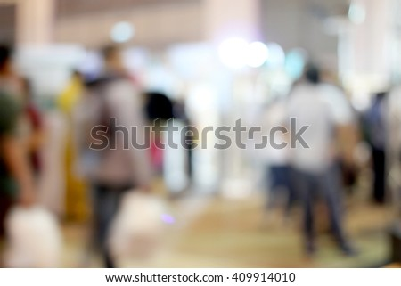 Blurred background. Blurred people walking. - stock photo