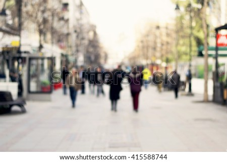Blurred background. Blurred people walking through a city street. Toned photo - stock photo