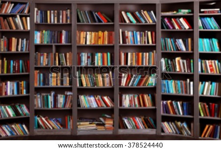 blurred background. bookshelf in public library
