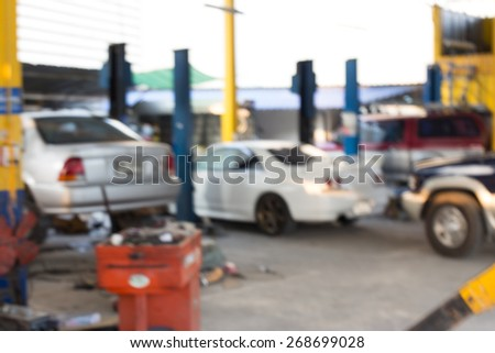 Blurred background : Car technician repairing the car in garage. - stock photo