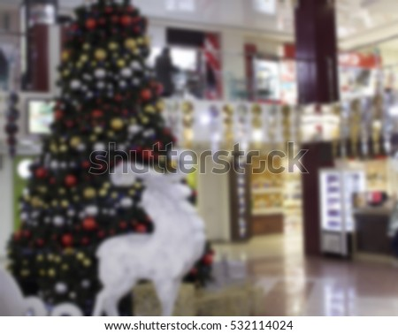 blurred background Christmas tree in a shopping center