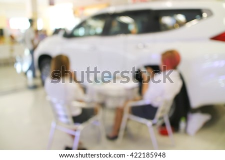 Blurred background consultants are individuals buying car - stock photo