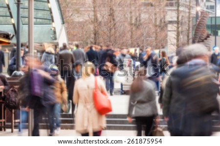 Blurred background, crowd of commuters in London, long exposure technique. Photo taken in Canary Wharf, financial district of the city, at rush hour. - stock photo
