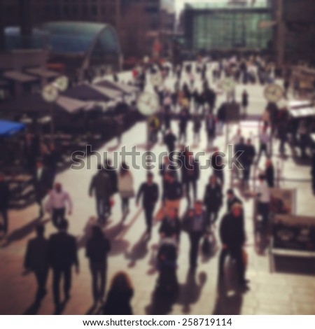 Blurred background, crowded Canary Wharf in London - stock photo